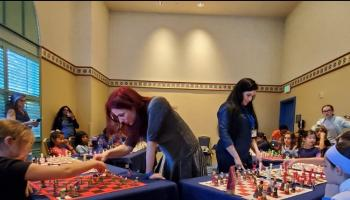 Jen Shahade and Carolina Blanco give a simul at the K-12 Nationals in Orlando, Florida