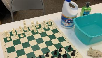 Chess boards being cleaned for the Iowa Closed