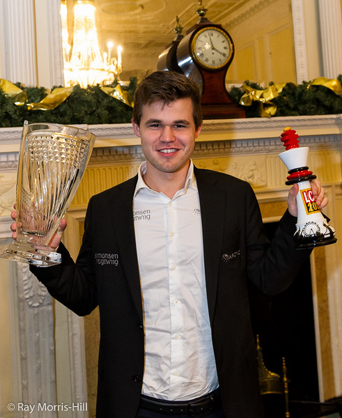 Magnus Carlsen less than one month after his blunder, holding his London Classic and Grand Chess Tour awards. Photo: Ray Morris-Hill.
